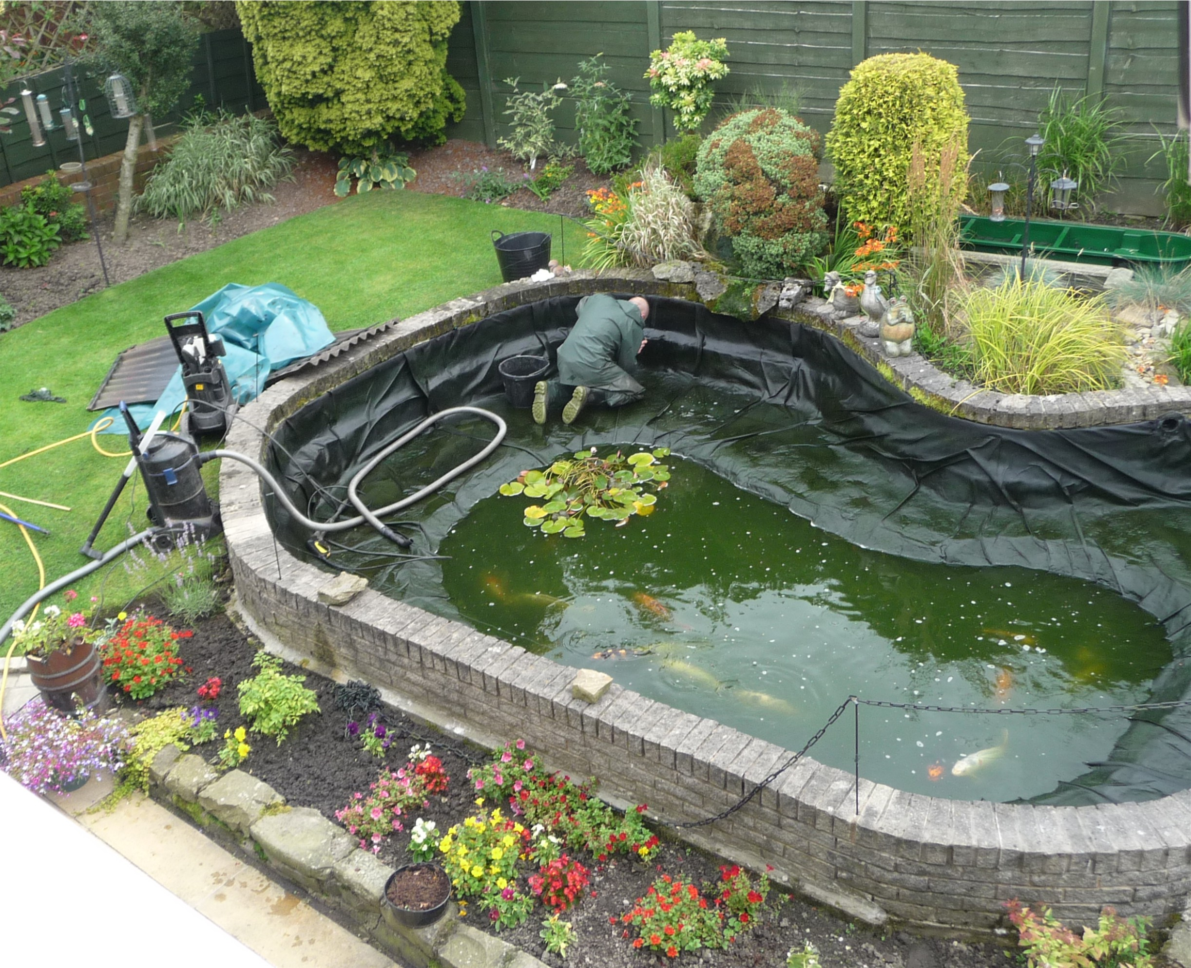 Pond maintenance services green 39 s aquatic services for Koi pond maintenance near me
